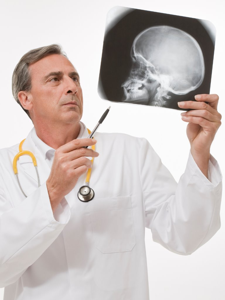 https://www.entincayman.com/wp-content/uploads/radiologist-reviewing-a-radiography-picture-id183061407.jpg